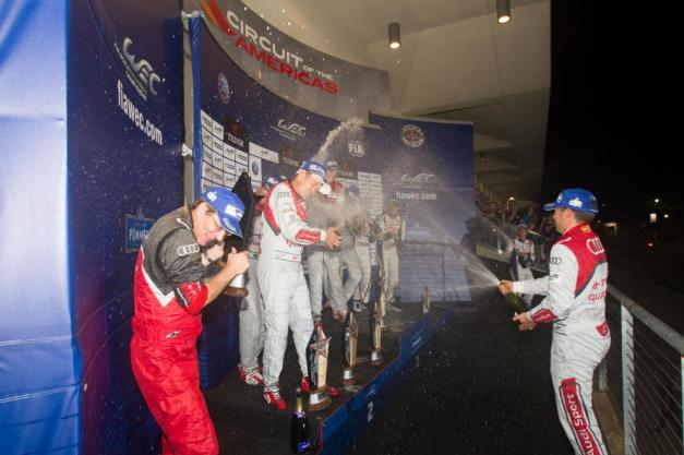 The Audi Sport Team Joest celebrate on the podium at the Circuit of the Americas following a 1-2 with the No. 2 of Marcel Fässler, André Lotterer and Benoît Tréluyer grabbing the overall victory.  Photo credit: WEC Media