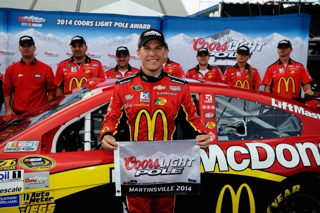 Jamie McMurray, driver of the #1 McDonald's Chevrolet, poses with the Coors Light Pole Award after qualifying for the pole for the NASCAR Sprint Cup Series Goody's Headache Relief Shot 500 at Martinsville Speedway on October 24, 2014 in Martinsville, Virginia. Photo credit: Rainier Ehrhardt/NASCAR via Getty Images