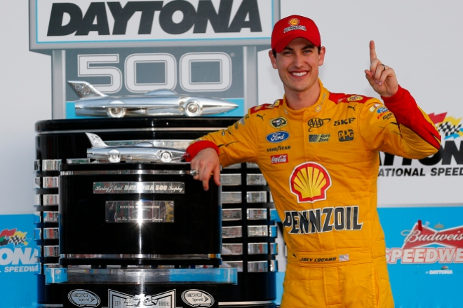 Joey Logano poses next to the Harley J. Earl trophy in Victory Lane after winning the Great American Race, the 57th annual Daytona 500. Photo: Chris Trotman/Getty Images