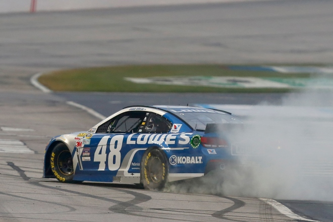 Jimmie Johnson celebrates at Atlanta Motor Speedway with a burnout after winning the Folds of Honor QuikTrip 500, adding to his legacy with career victory No. 71. Just five behind NASCAR legend Dale Earnhardt on the all-time wins list. Photo: Matt Sullivan/NASCAR via Getty Images